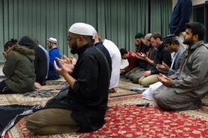 men praying at bene house